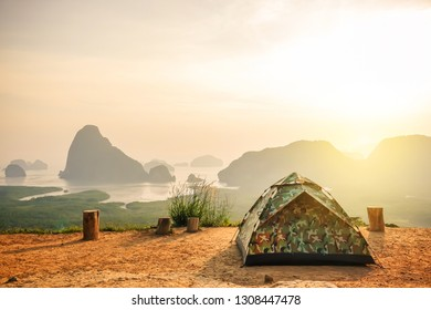 Tent Camping on the high mountains with blue sky in morning at samet nangshe, Phang Nga province,Thailand