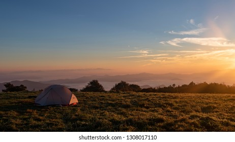 Tent campsite at sunrise on Huckleberry knob in North Carolina