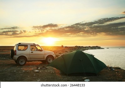 Tent and car on sea shore