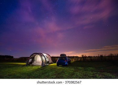 Tent and Car Under the Stars