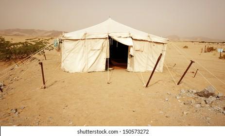 Tent in desert under hot weather