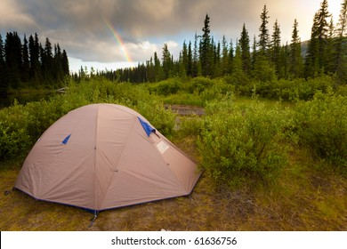 Tent at the end of the rainbow on bank of Big Salmon River, Yukon T., Canada