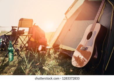 tent and guitar.adventure, travel, tourism, camping concept.