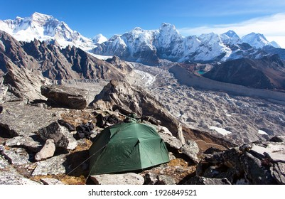 Tent in Himalayas mountains. Mount Everest from Gokyo peak and Ngozumba glacier, Gokyo valley, Nepal Himalaya mountain