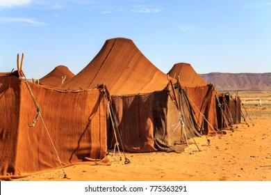 Tent house in desert in a row covered with brown cloth