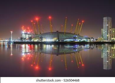 tent in London at night with water reflection