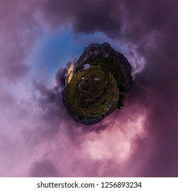tent in the mountains against the backdrop of purple clouds at sunset. Tiny planet 360vr panorama