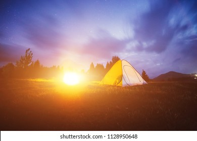 Tent in the mountains. Night photo