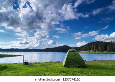 Tent near the dam under the beautiful clouds