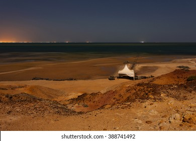A tent on a beach of the Atlantic Ocean, in Western Sahara (at night)