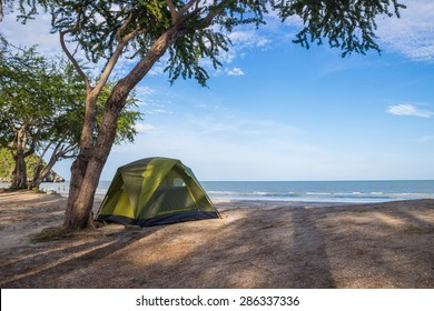 tent on the beautiful beach and sky background