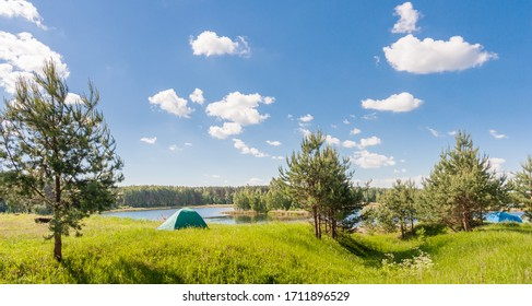 Tent on the lake in summer in Russia