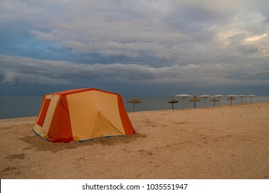 tent on sandy beach on a background of sea landscape. ecological travel alone with myself.