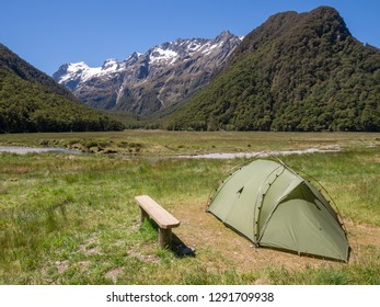 A tent pitched at Routeburn Flats Hut Campsite on Routeburn Track, New Zealand