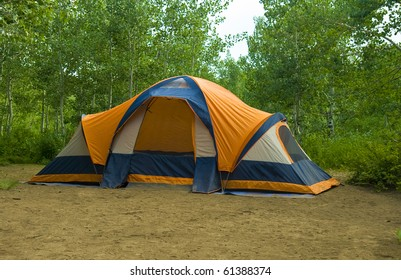 Tent set up in lush green campground