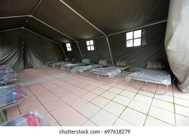 Tent shelter with temporary beds ready for natural disaster refuges