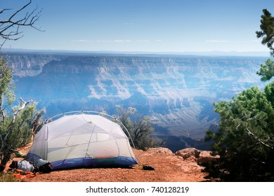 A tent with things on the edge of the cliff.  Point Sublime, North Rim Grand Canyon National Park Arizona, US