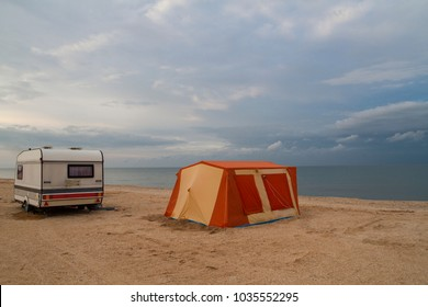 tent and trailer stand on the beach. romantic journey for solitude. seascape unpopulated