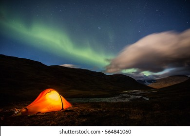 Tent under Aurora Borealis on the Nordkalottleden in Sweden