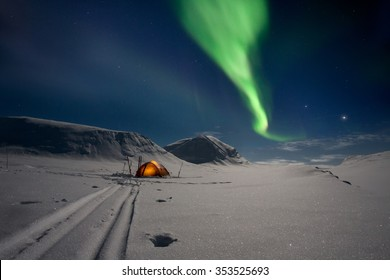 Tent under northern Lights in Lapland - Sweden