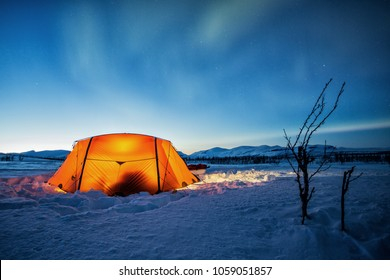 Tent under Northern Lights on the Kungsleden in the Wintertime - Lapland-Sweden