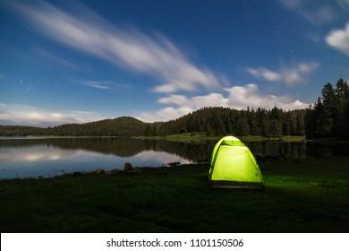 Tent under the stars on the dam Shiroka Poliana in Rodopi mountain, Bulgaria