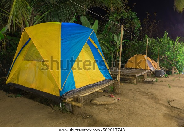 Tent yellow camping in the nature at night