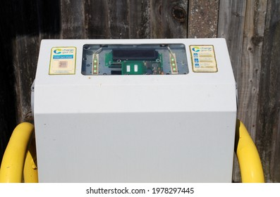 TENTERDEN, ENGLAND - APRIL 26, 2021: An electric vehicle charging unit in a car park at Tenterden in Kent. Sales of diesel and petrol vehicles will be phased out by 2030 in the UK.