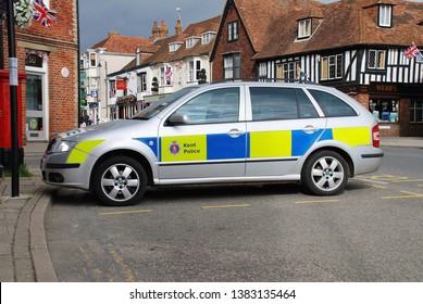 TENTERDEN, ENGLAND - JULY 1, 2012: A Kent police Skoda patrol car parked in the High Street. Tenterden police station closed in 2012, with policing now being provided from neighbouring Ashford.