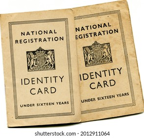 TENTERDEN, ENGLAND - JULY 23, 2021: A pair of British National Identity Cards for children under sixteen. Launched in 1939 at the start of the Second World War, they were discontinued in 1952.