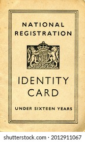 TENTERDEN, ENGLAND - JULY 23, 2021: A British National Identity Card for a child under sixteen. Launched in 1939 at the start of the Second World War, they were discontinued in 1952.