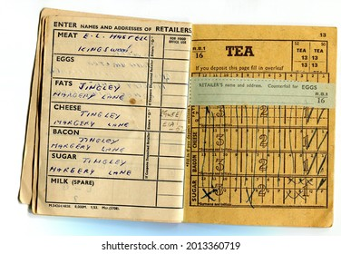 TENTERDEN, ENGLAND - JULY 23, 2021: A British food ration coupon book. Introduced in 1940 during the Second World War, rationing was ended in 1954.