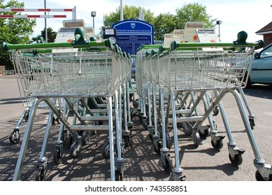 TENTERDEN, ENGLAND - MAY 17, 2008: Shopping trolleys outside a branch of supermarket chain Waitrose in Kent, England. Part of the John Lewis Partnership, the first Waitrose supermarket opened in 1955.
