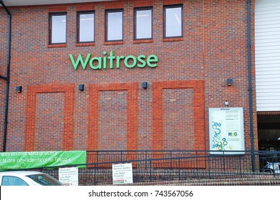 TENTERDEN, ENGLAND - MAY 17, 2012: The red brick exterior of a branch of supermarket chain Waitrose in Kent, England. Part of the John Lewis Partnership, the first Waitrose supermarket opened in 1955.