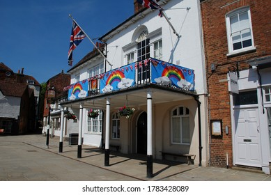 TENTERDEN, ENGLAND - MAY 27, 2020: Tenterden Town Hall decorated with rainbow banners in support of key workers during the Corona Virus pandemic. The historic building dates from 1790.