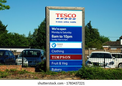 TENTERDEN, ENGLAND - MAY 31, 2020: Signage outside a branch of the Tesco supermarket chain. Founded in 1919, the company currently has 6800 stores and is the biggest supermarket in the UK.