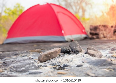 Tent,fire,Camping in mountains,Tourist red tents in forest at campsite,Fire in the campsite,Camping in the morning and the ashes of the fire