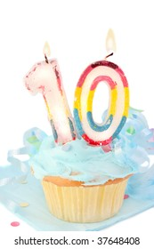 tenth birthday cupcake with blue frosting on white background