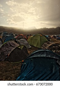 Tents of camp of a festival in heavy rain
