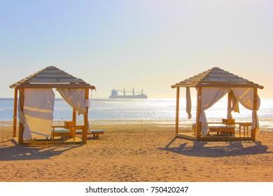 Tents fot recreation on the beach at sun light
