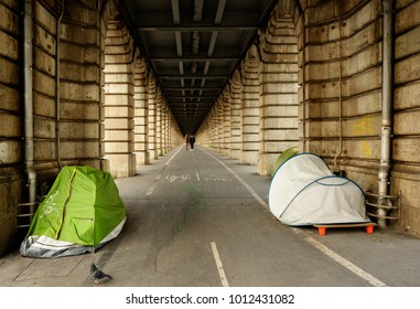 Tents of homeless people under subway viaduct in Paris