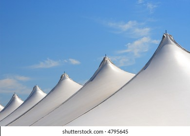 Tents on blue sky