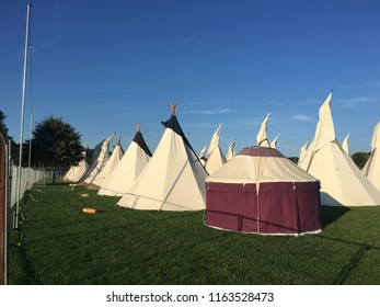 Tents and Teepees at a music festival camp site.