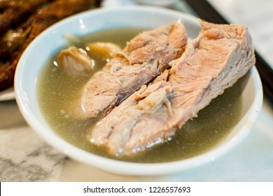 Teochew style Bak Kut Teh (Pork bone soup) in clear broth with pepper and garlic is a signature Singapore food