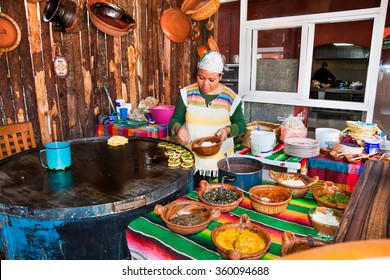 TEOTIHUACAN, MEXICO - DEC 4, 2015: Mexican restaurant chef in Teotihuacan, Mexico on Dec 4, 2015. Mexican food is well-known for its exotic flavors and the use of strong spices.