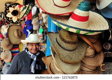 TEOTIHUCAN - FEB 26:Mexican man wears a sombrero selling sombreros and cowboys hats on February 26 2010 in Teotihuacan, Mexico.its name derived from the Spanish word sombra, meaning shade.