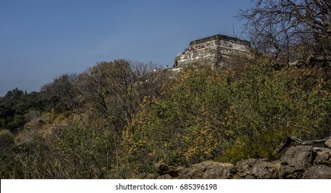 """Tepoztlan, Mexico - January 4, 2017: Visitors on """"El Tepozteco"""", archaeological site in the state of Morelos. The temple is dedicated to Tepoztecatl, the Aztec god of the alcoholic beverage pulque."""