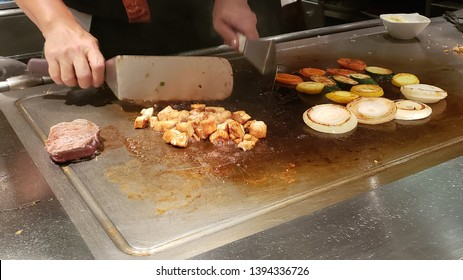 Teppanyaki style food being prepared on the iron grill