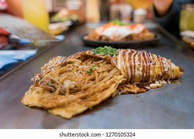 Teppanyaki and Yakisoba on hot pan. Japanese Food