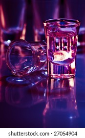 tequila drink in bar with purple light